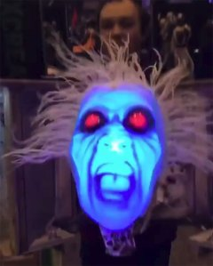 A Terrifying Screaming Ghost Head Lunges Out of a Special Effects Box at Victims