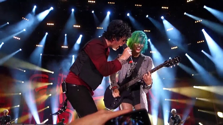 Billie Joe Armstrong Invites a Green Haired Audience Member Onstage to Play Guitar for Green Day