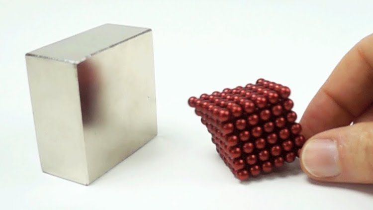 Mesmerizing Slow Motion Footage of Small Magnets Completely Engulfing Larger Magnets