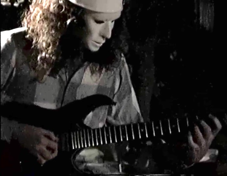 Buckethead Shreds Solo After Solo During a Family Reunion Backyard Performance in 1991