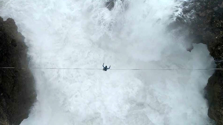 Astonishing Drone Footage of a Slackliner Battling the Elements While Crossing Over Crashing Waves