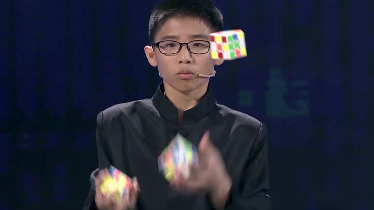 Teenager Sets Guinness World Record for Fastest Time Solving Three Rubik's Cubes While Juggling