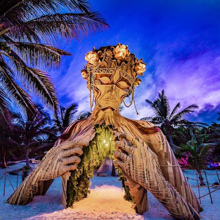 Gorgeous Beachside Wooden Sculpture of a Woman Opening Her Heart to Visitors of Tulum, Mexico
