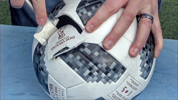 Cutting Open FIFA World Cup Soccer Balls From 1930, 1970 and 2018 to See What's Inside