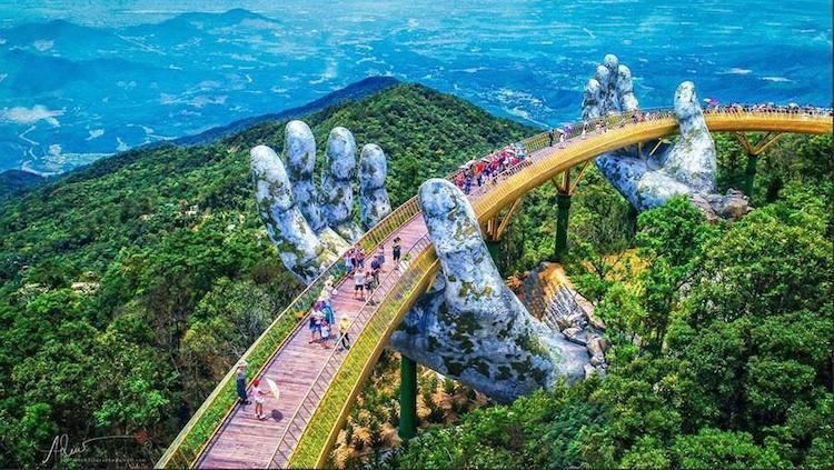 Pair of Giant Cradling Hands Suspend a Golden Bridge in the Bà Nà Hills Near Da Nang, Vietnam