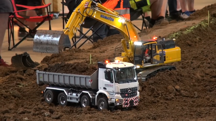 Remote Control Construction Vehicles Diligently Perform Tasks Around Gigantic RC Construction Site