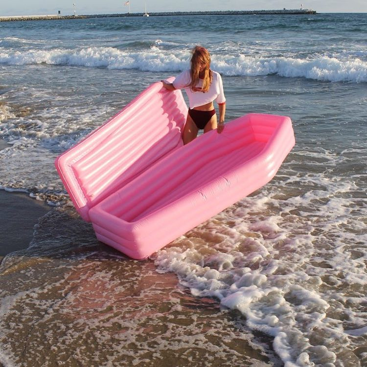 A Hilarious Inflatable Pink Coffin Pool Float
