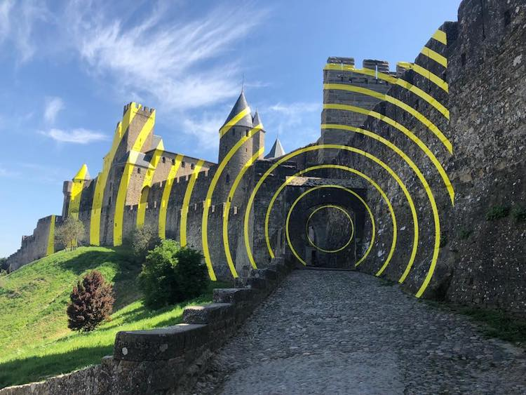 Artist Installs Bright Yellow Illusory Concentric Circles on the French Fortified City of Carcassonne