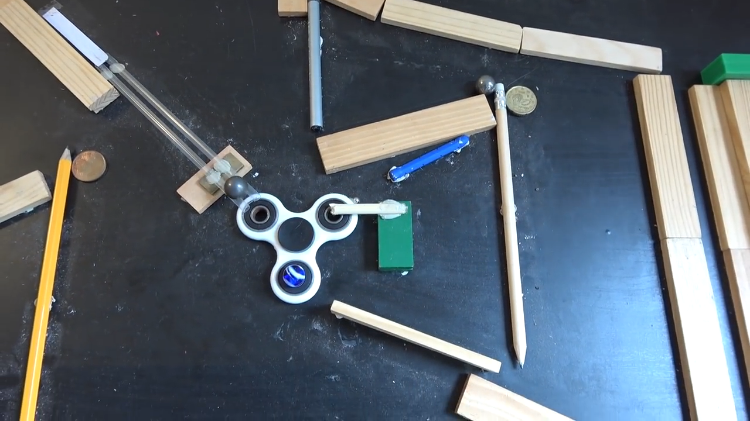 An Ingenious Tabletop Rube Goldberg Inspired Game That Keeps a Bright Blue Marble in Play at All Times