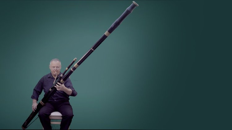Musician Demonstrates the Wide Tonal Range of a Giant Contrabassoon That Is Twice His Size