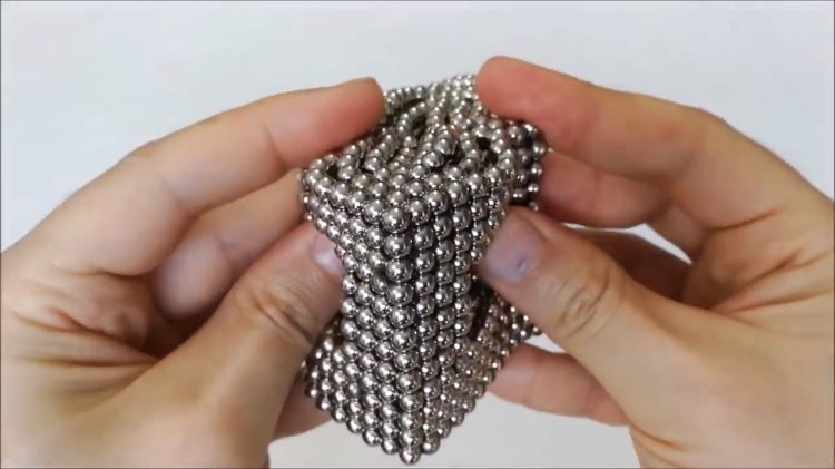 Visually Satisfying Footage of Beautiful Geometric Magnetic Sculptures Being Destroyed in Reverse