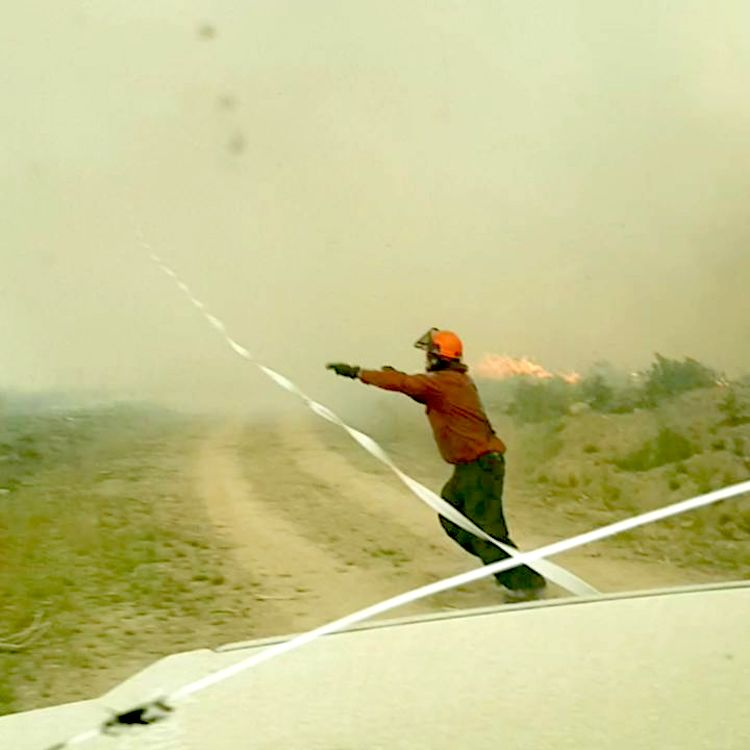 The Powerful Force of a Raging Wildfire Tornado Pulls a Fire Hose 200 Feet Straight Up Into the Air
