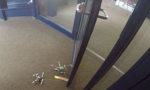 Drones Work Together to Open Door