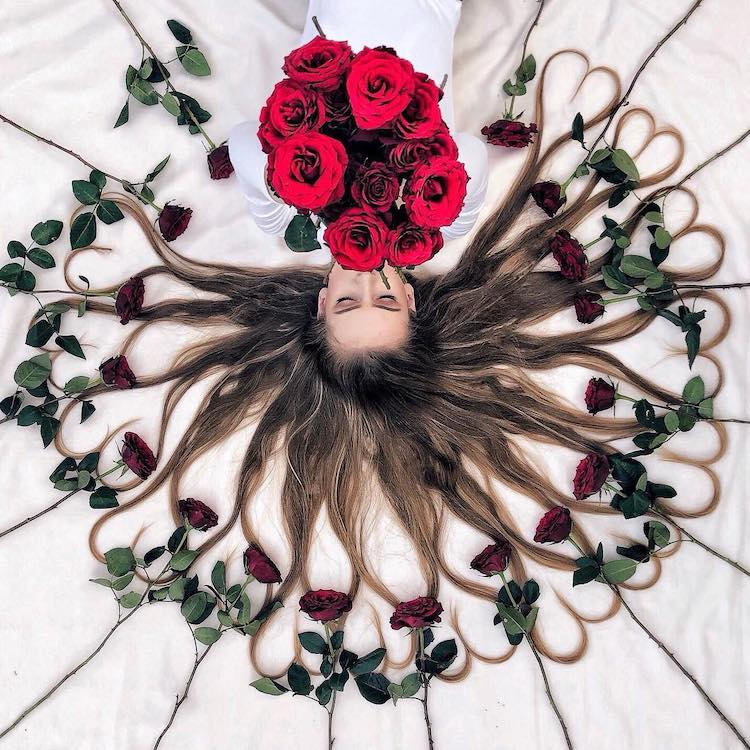 Dutch Artist Captures Beautiful Portraits That Feature Her Long Thick Hair Laid Out Entwined With Flowers