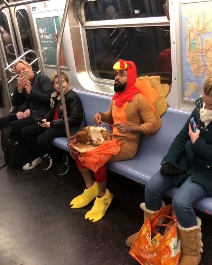 Man Dressed As Turkey Eating a Turkey