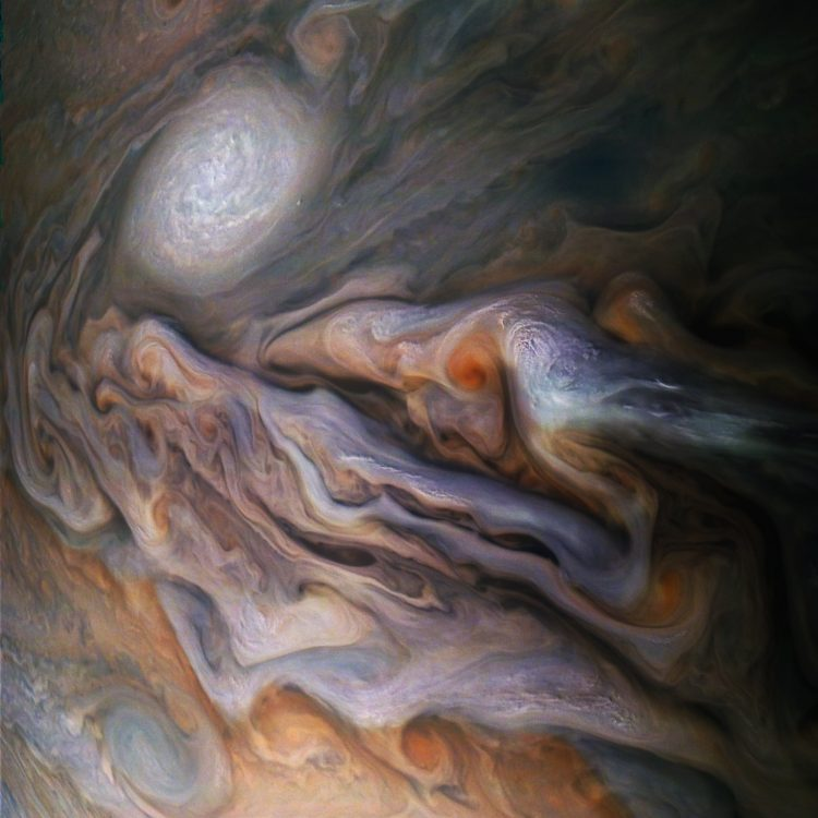 NASA Juno Probe Captures a Stunning Close Up Image of a White Oval Shaped Anticyclonic Storm on Jupiter