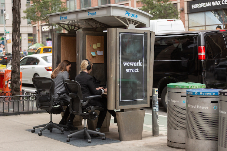 Improv Everywhere Transforms a Pair of Unused NYC Pay Phone Booths Into Outdoor Coworking Spaces