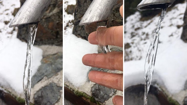 Flowing Alpine Water That Appears Completely Frozen