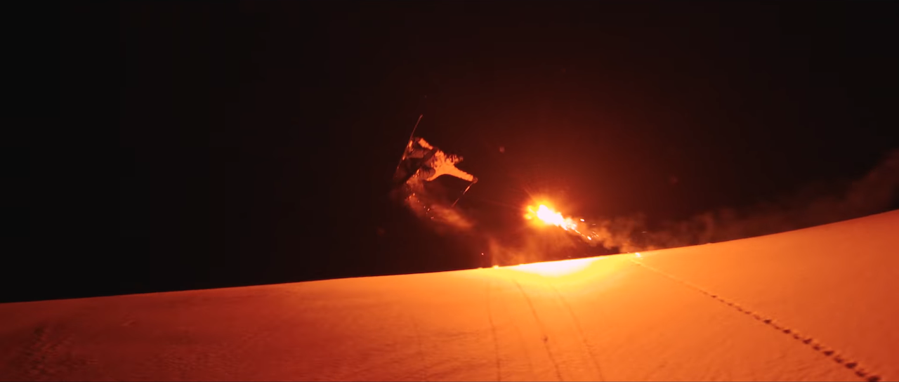Nighttime Skiing Lit by Red Flares Fired Overhead