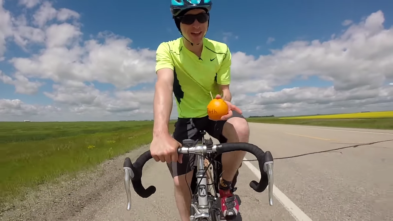 Scientist Proves the Earth Is Round Using Two Sticks and an Orange While Bicycling a Saskatchewan Road