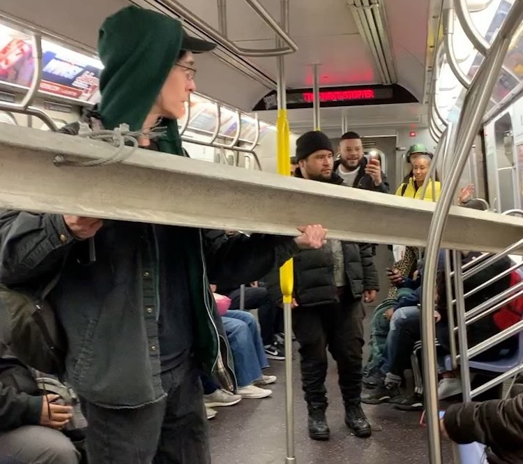NYC Commuters Help Man With Beam on Subway