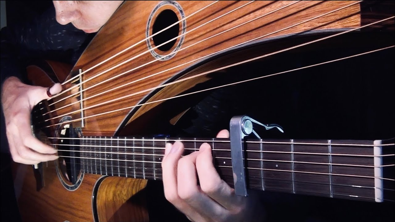 Jamie Dupuis Plays a Rich Acoustic Cover of the Game of Thrones Theme on His Signature Harp Guitar