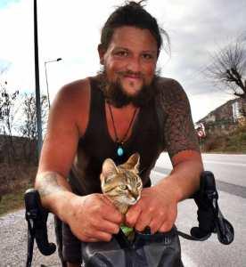Man on Bicycle Adopts Kitten