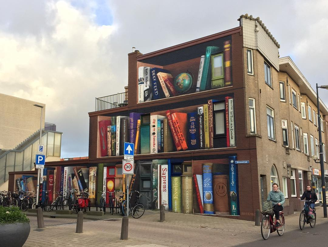 Street Artists Turn Utrecht Apartment Building Into a Giant Bookcase Featuring Residents' Favorite Books