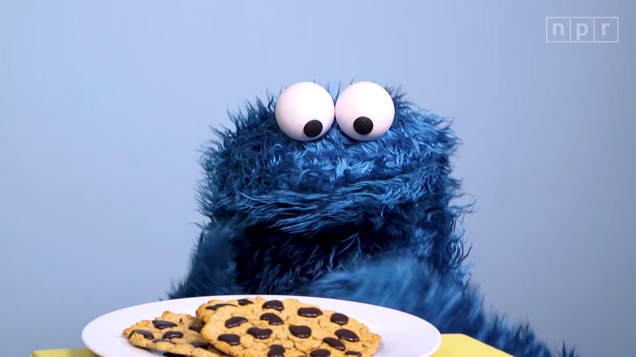 Cookie Monster Practices Self-Control, Denying Himself the Pleasure of Eating Cookies Until His Friend Arrives