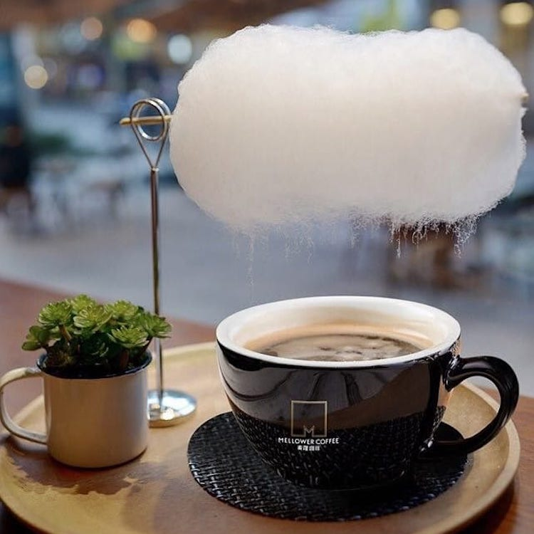 A Fluffy Cotton Candy Cloud Drips a 'Sweet Little Rain' of Sugar Into a Hot Cup of Coffee From Overhead