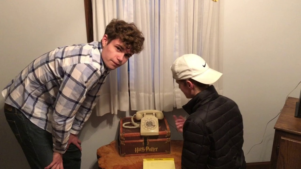 Teens Try to Dial Rotary Phone