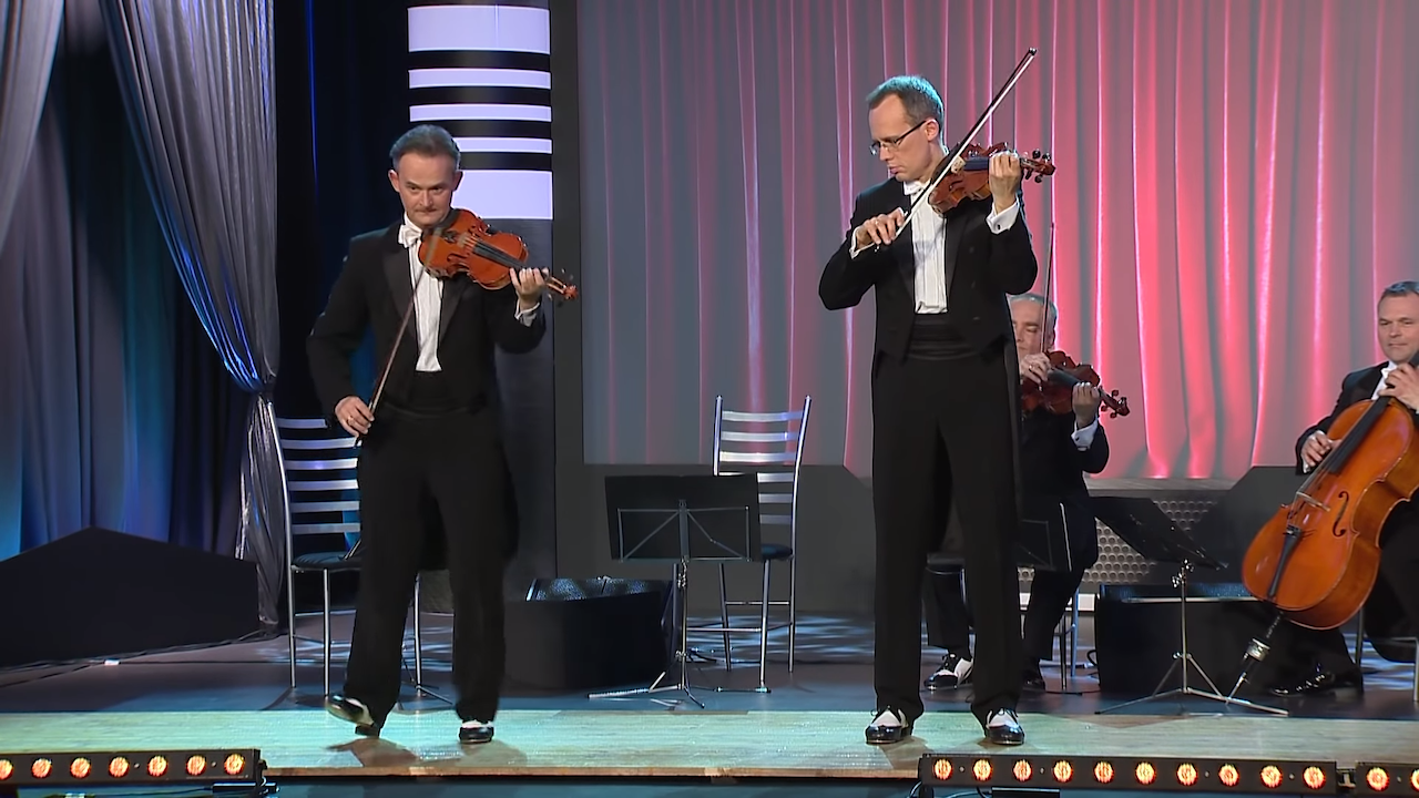 Musicians Flawlessly Play Their Instruments While Performing