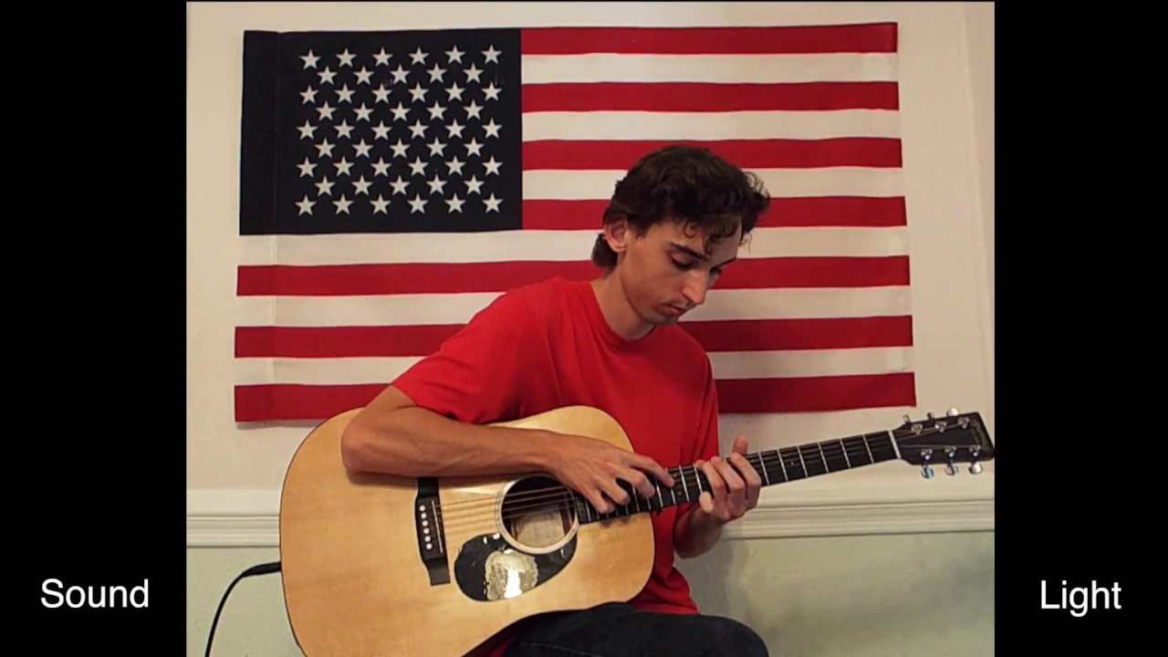 musician simultaneously performs 39 amazing grace 39 and 39 the star spangled banner 39 on one acoustic. Black Bedroom Furniture Sets. Home Design Ideas