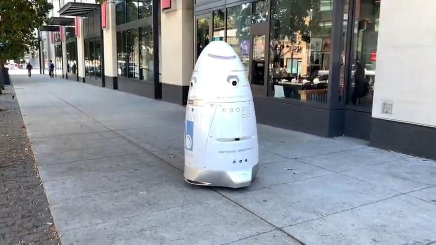 Security Robot Patrolling a Sidewalk in San Francisco