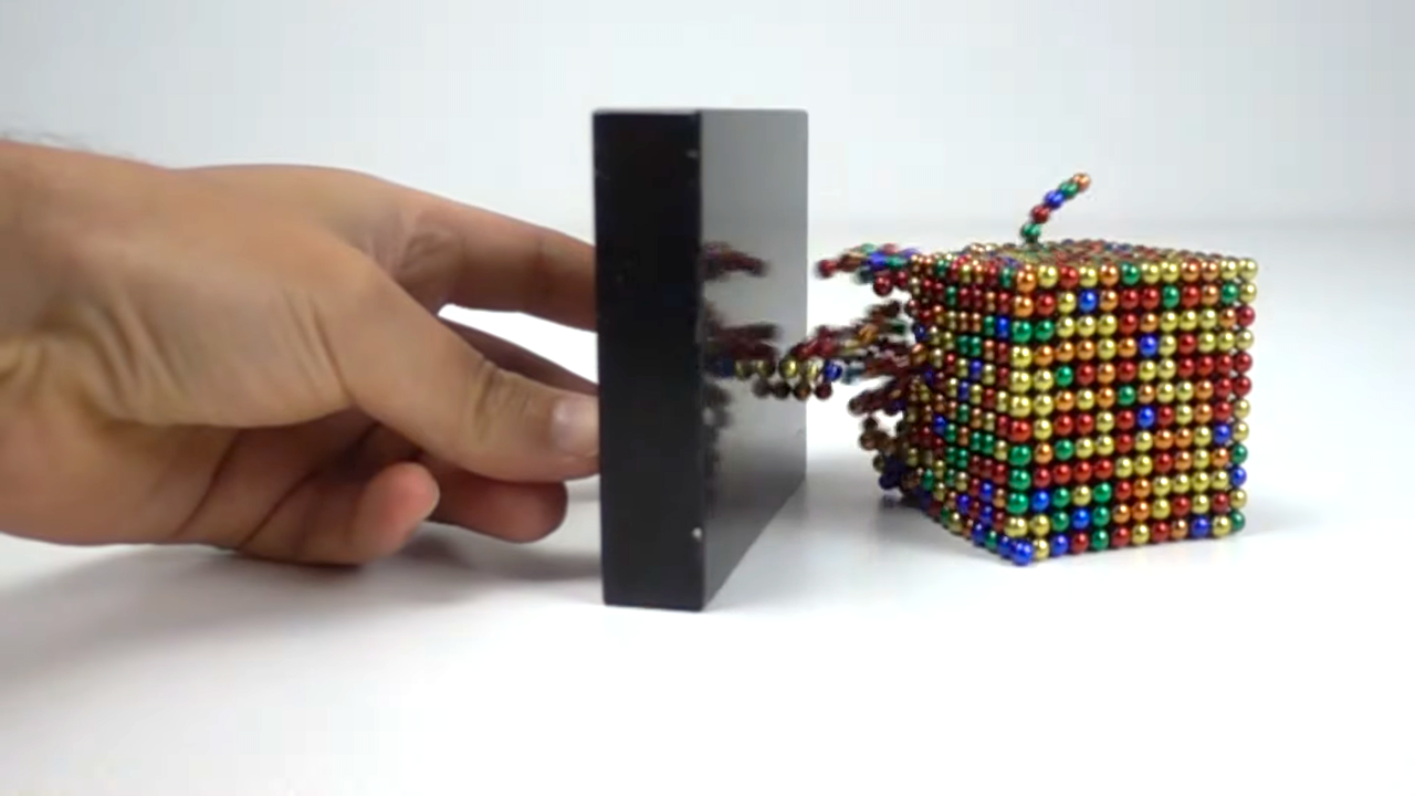 Mesmerizing Footage of the Powerful Attraction Between Super Strong Magnets and Magnetic Balls