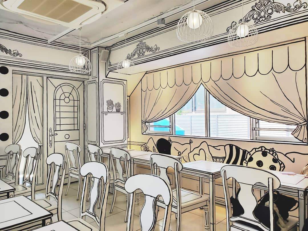 A Café in Tokyo That Is Whimsically Designed to Look Like the Two Dimensional Pages of a Coloring Book