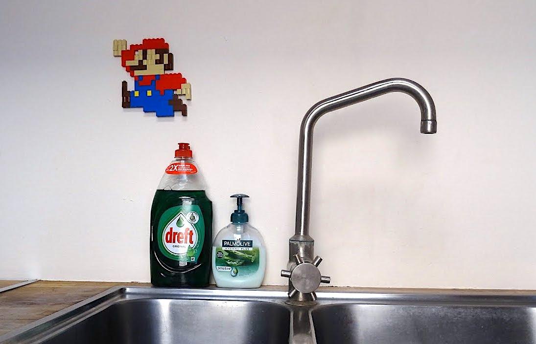 A Real Life 8-Bit Mario Runs Amok Around the House