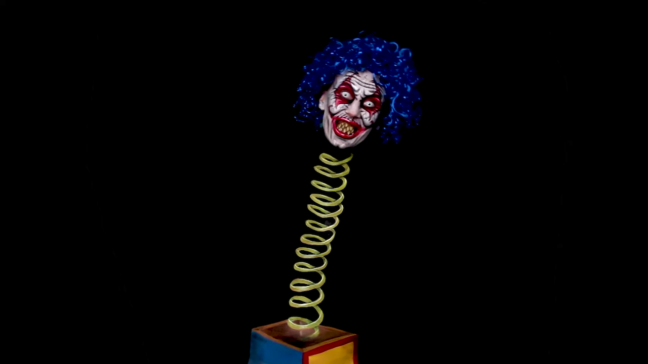 Bodypainting Artist Uses Strategic Makeup To Turn Herself Into a Creepy Jack-in-the-Box on a Spring
