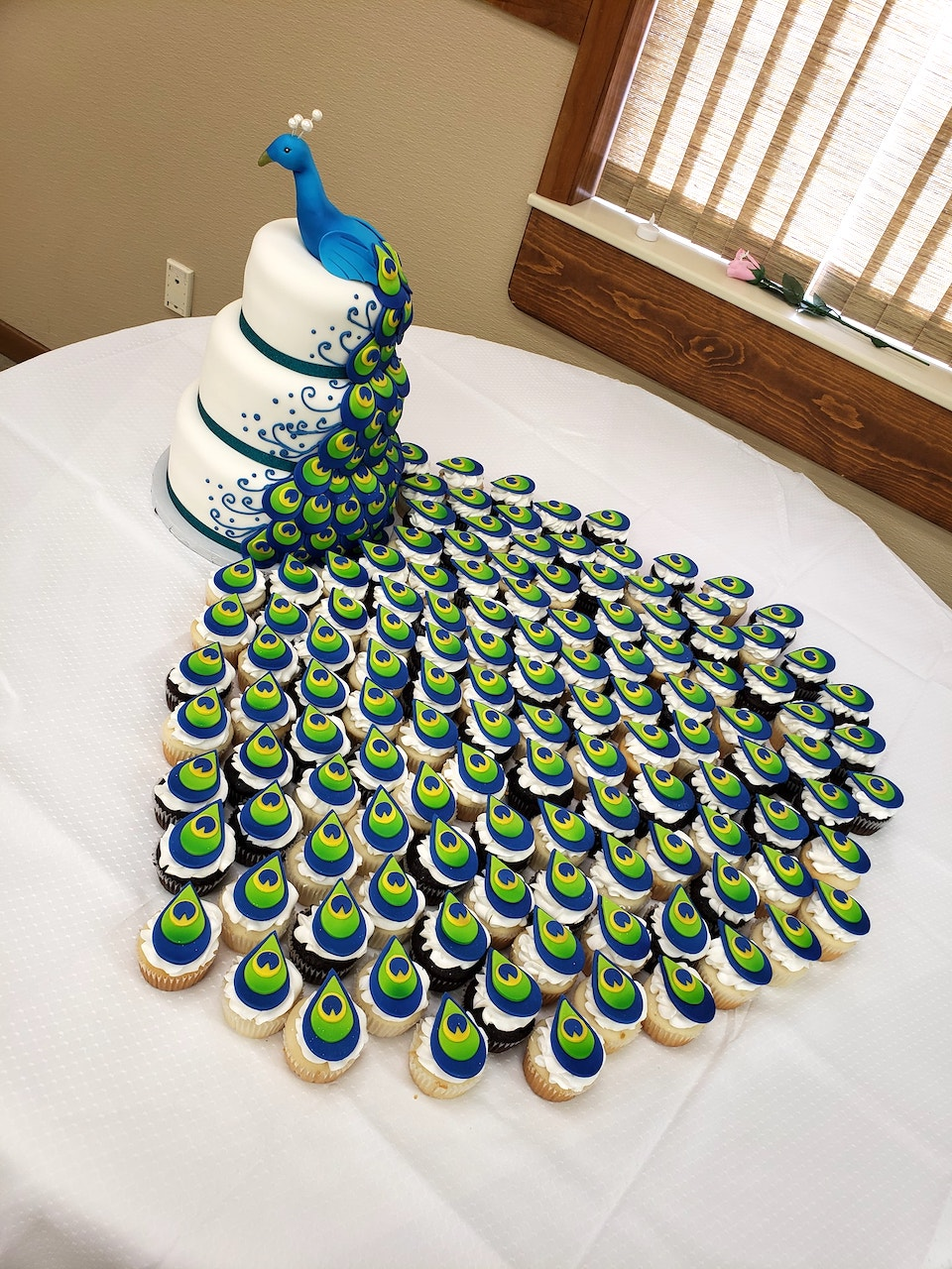 A Gorgeous Peacock Cake With Cupcake Tail Feathers