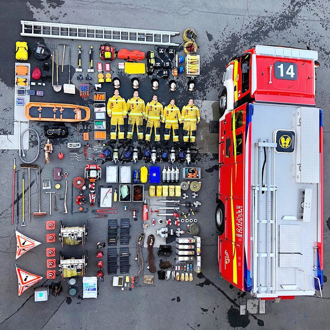 Organized Inventories of Emergency Services Including Crews Lying Next to Their Vehicles in Overhead Photos