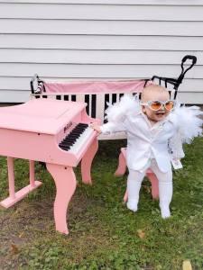 Baby Elton John with Pink Piano