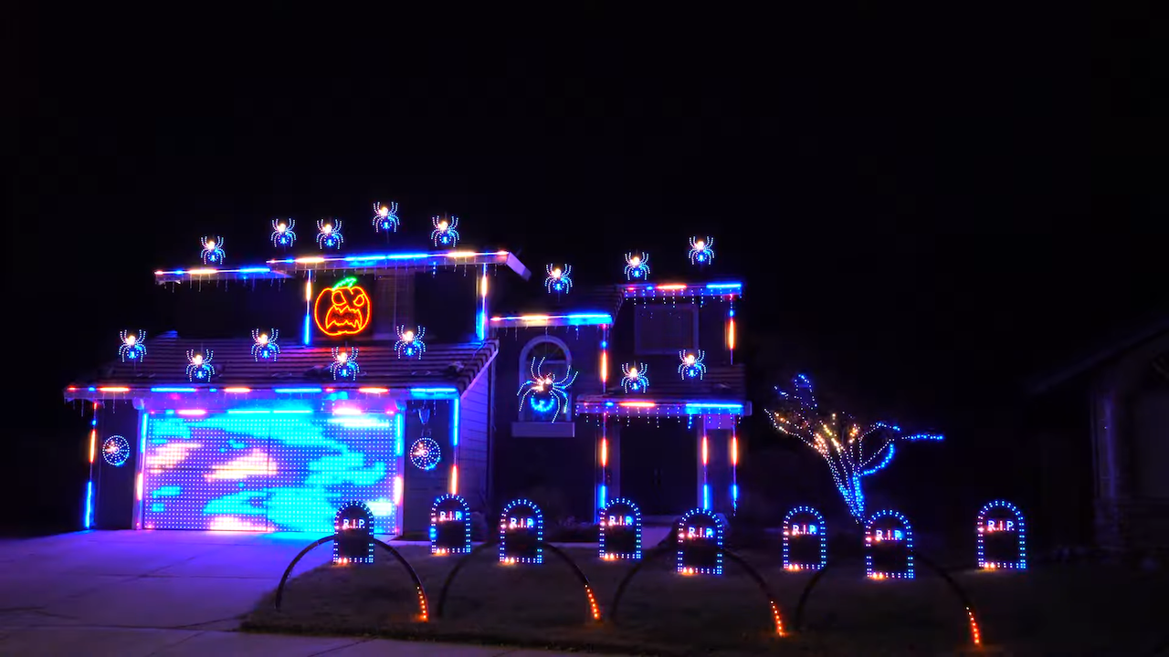 An Incredible Ghostbusters Halloween Light Show With a Badass Pumpkin Singing 'I Ain't Afraid of No Ghost'