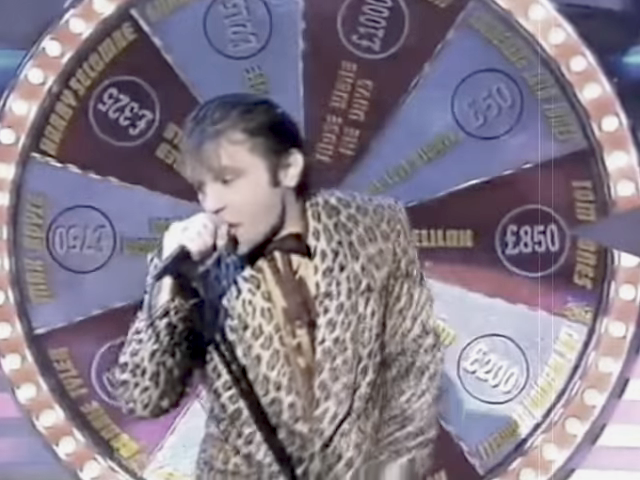 Bruce Dickinson Sings 'Delilah' by Tom Jones While Wearing a Leopard Suit on a Game Show in 1997