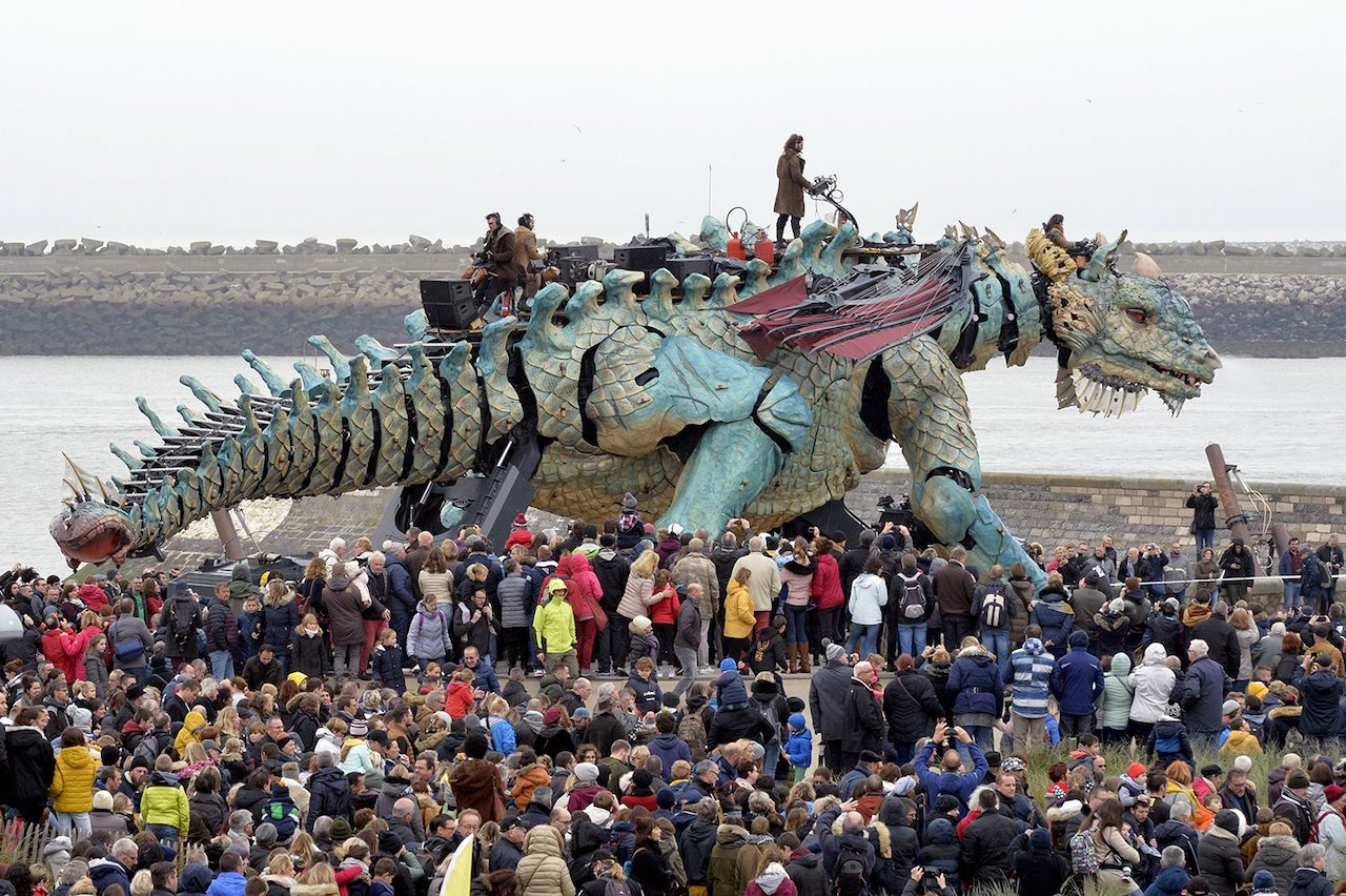 A Giant Fire-Breathing Mechanical Dragon Operated by 17 People Parades Through the Streets of Calais