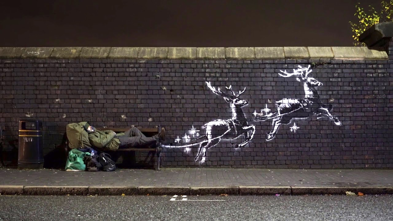 Banksy Installs Two Stenciled Reindeer Next to a Birmingham Bench to Raise Homelessness Awareness