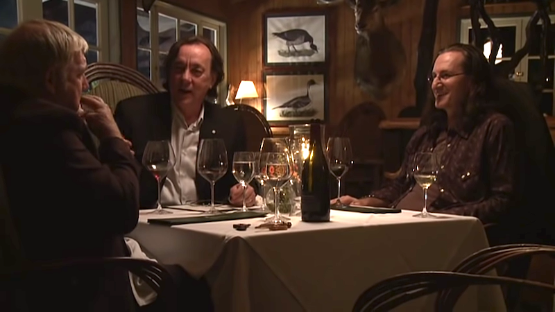 Geddy Lee, Neil Peart and Alex Lifeson of Rush Enjoy a Hilariously Drunken Meal at a Hunting Lodge in 2010