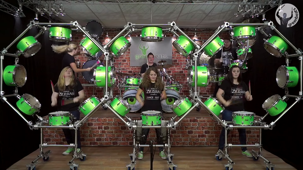 Drummers Play Eight Green Snare Drums in the Round