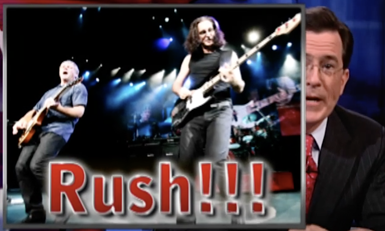 The Members of Rush Sign Steven Colbert's Hand During Their First Television Appearance in 30 Years - laughing squid