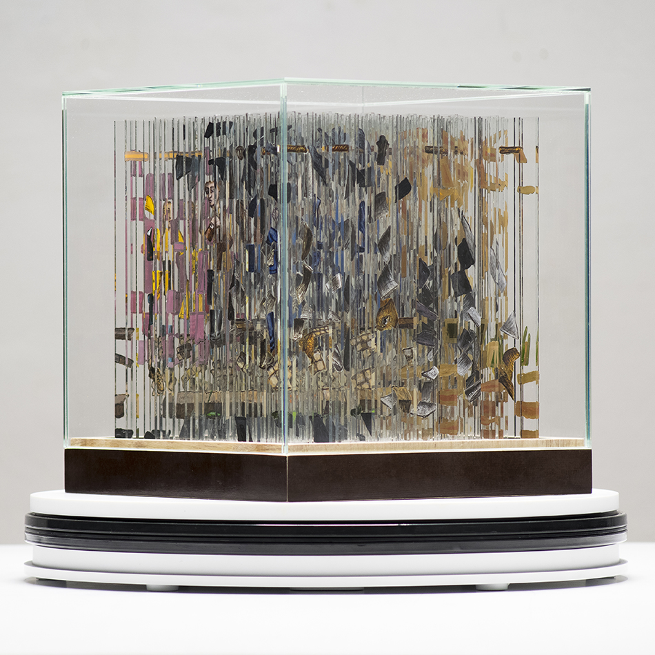 A Rotating Anamorphic Cube With Hand Painted Glass Strip Images That Are Revealed With Each Turn