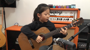 Six Year Old Girl Plays Fly Me to the Moon Classical Guitar